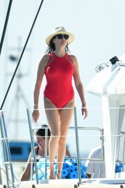 Lauren Silverman in Red Swimsuit on a catamaran in Barbados