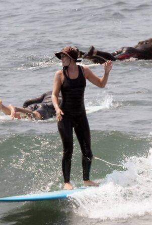 Leighton Meester - Surfing candids in Malibu