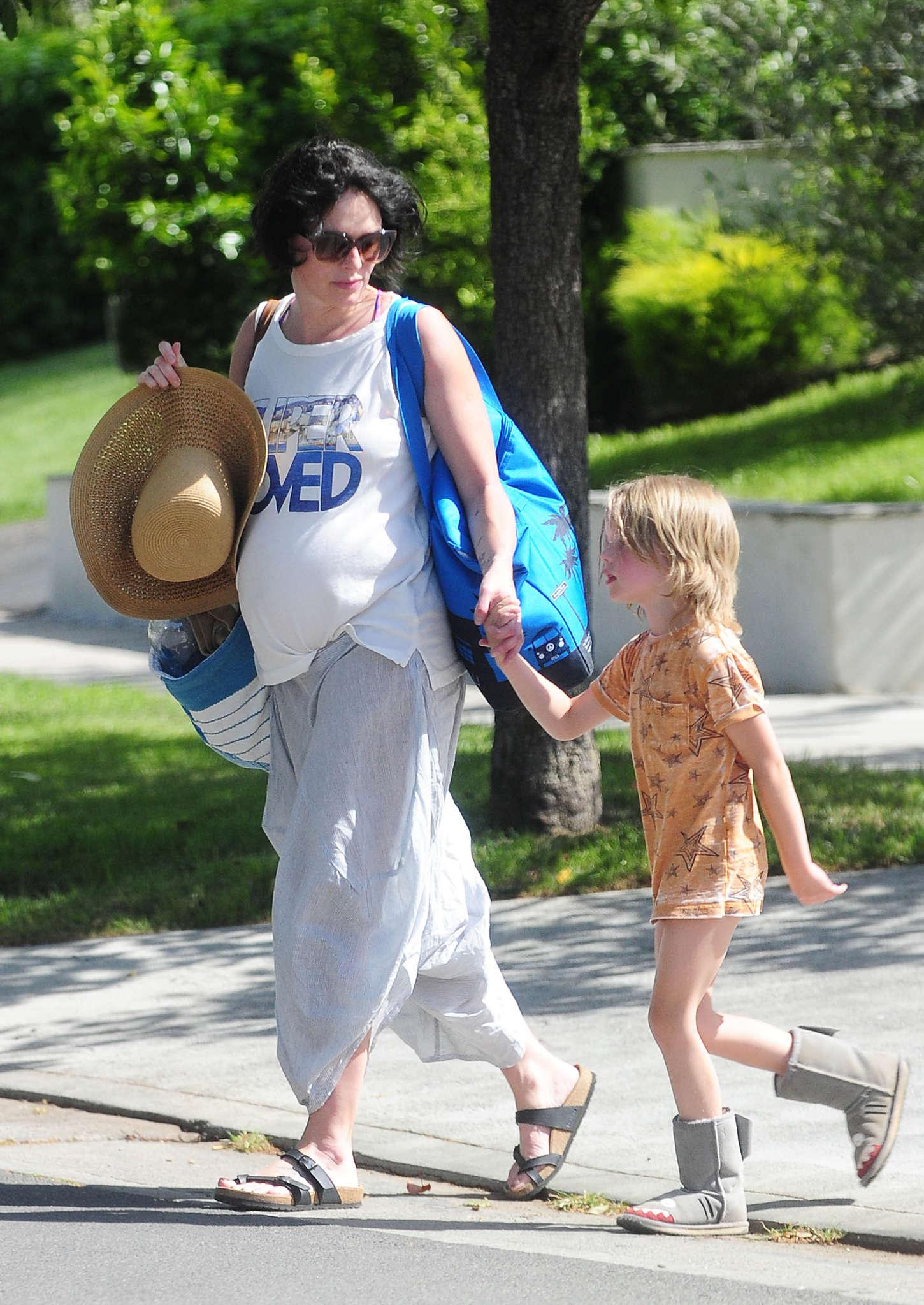 Lena Headey 2015 : Lena Headey: Leaving a pool party with her son -01