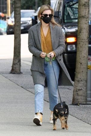 Lili Reinhart - Dons Converse sneakers as she takes dog Milo out for a walk in Vancouver
