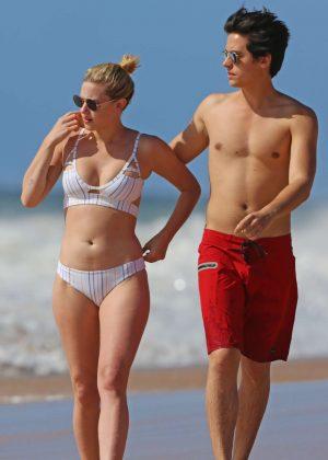 Lili Reinhart in Bikini with Cole Sprouse on the beach in Hawaii