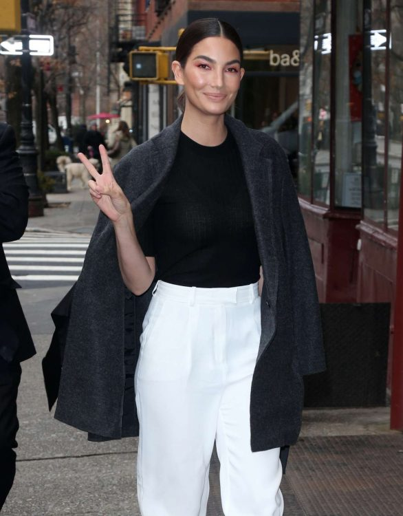 Lily Aldridge - Heads into a building for business in New York