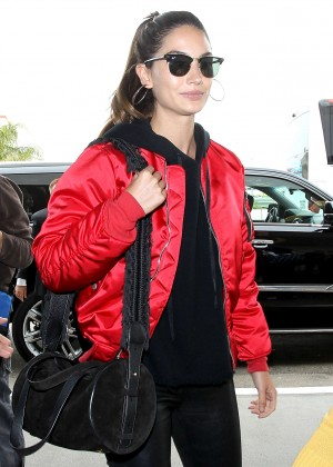 Lily Aldridge in red satin jacket at LAX Airport in Los Angeles