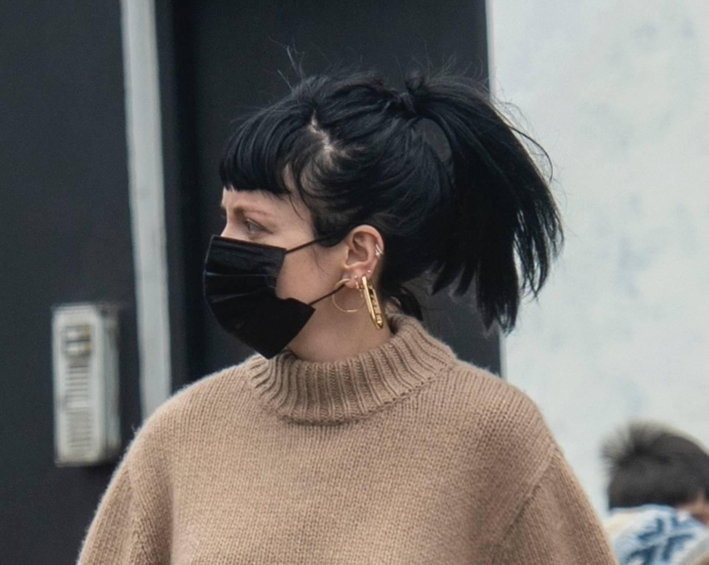 Lily Allen - Shows her ear piercings in London
