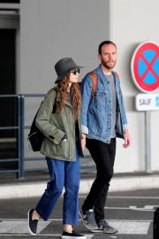 Lily Collins and her boyfriend Charlie McDowell - Arrived in Paris