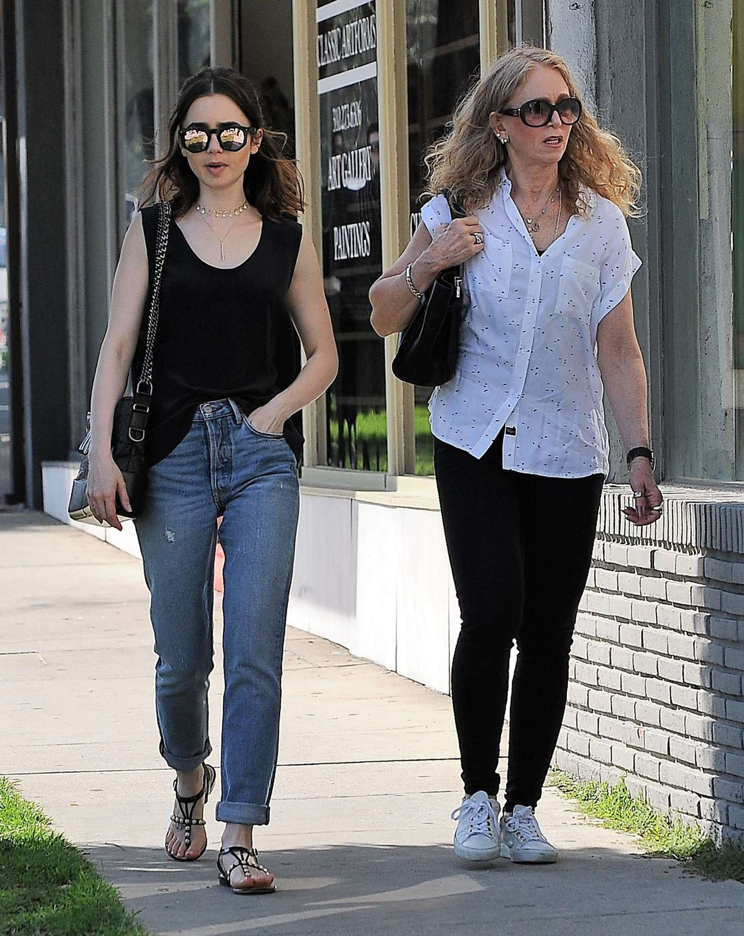 Lily Collins And Her Mother Jill Tavelman Out In West Hollywood 01 Gotceleb Inside the west hollywood antique store waverly on doheny, near the troubadour theater, jill tavelman collins is stationed under a framed image of the peanuts comic strip character lucy van. lily collins and her mother jill
