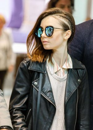 Lily Collins Arrives at Heathrow Airport in London
