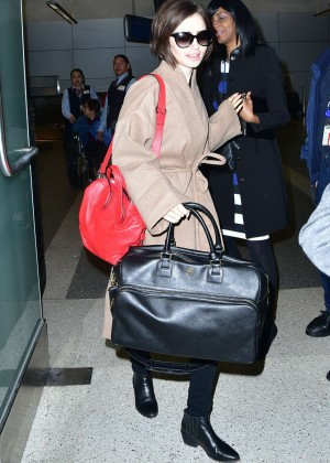 Lily Collins - Arrives at LAX Airport in LA