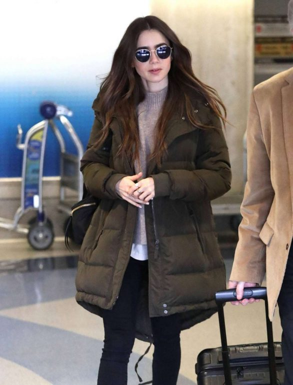 Lily Collins - Arrives at LAX in Los Angeles