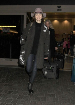 Lily Collins - Arrives at Los Angeles International Airport