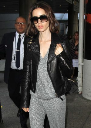 Lily Collins - Arriving at LAX Airport in Los Angeles