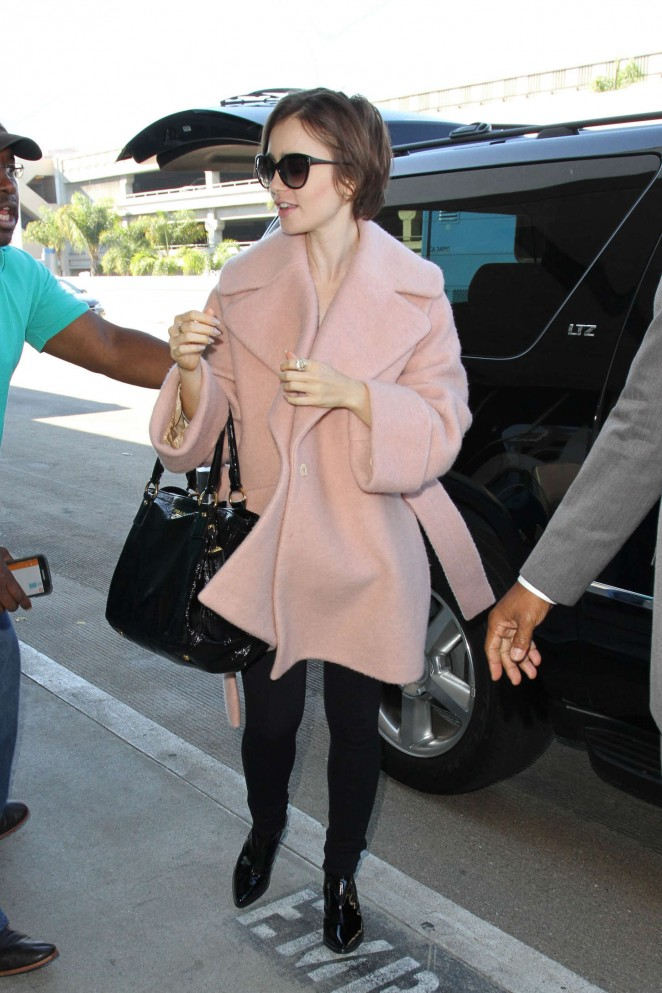 Lily Collins - Arriving at LAX in Los Angeles