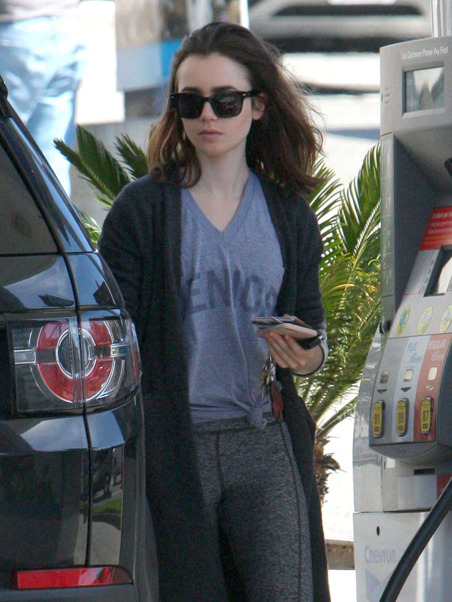 Lily Collins at a gas station in Beverly Hills