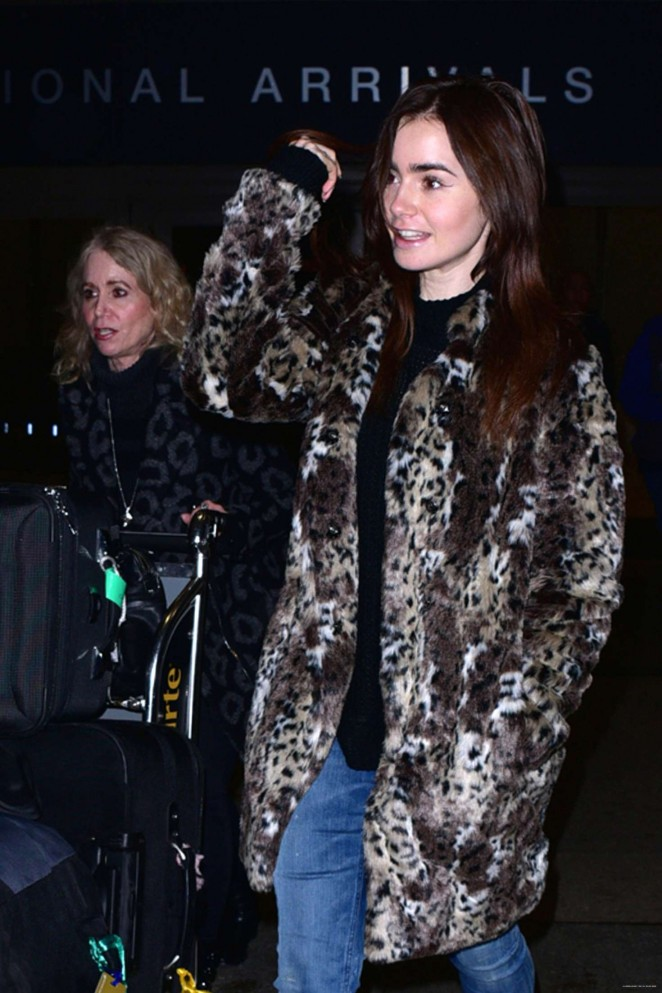 Lily Collins at LAX Airport -04