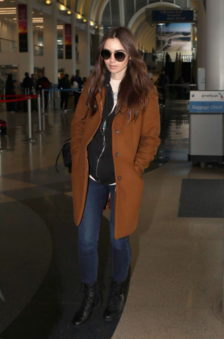 Lily Collins at LAX Airport in Los Angeles -03