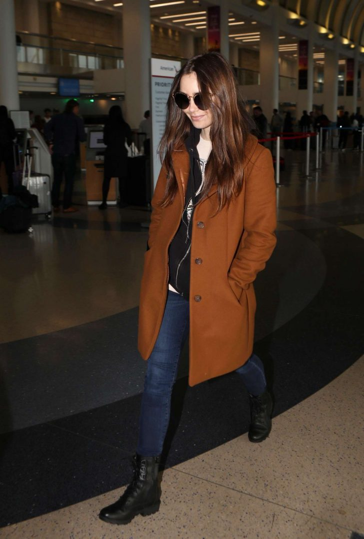 Lily Collins at LAX Airport in Los Angeles -06