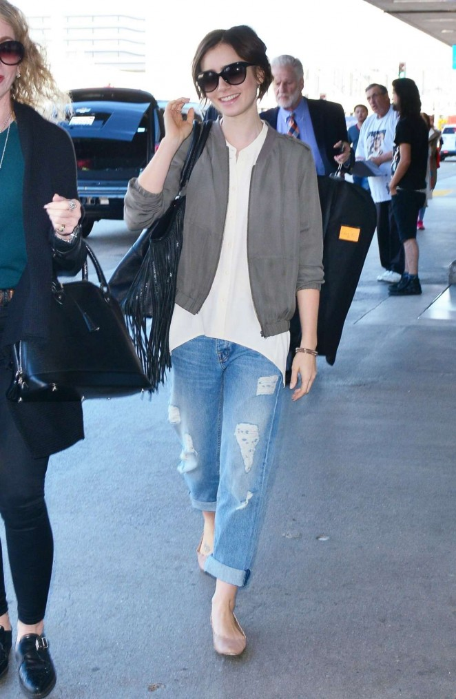 Lily Collins in Jeans at LAX Airport in Los Angeles