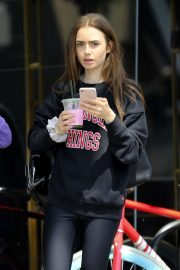 Lily Collins - Exiting Dogpound Gym with a friend in LA