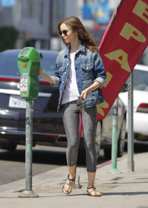 Lily Collins feeding the parking meter in Beverly Hills