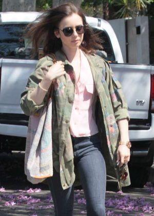 Lily Collins in a floral-print camouflage jacket in West Hollywood