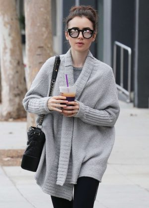Lily Collins in a granny sweater out in Los Angeles