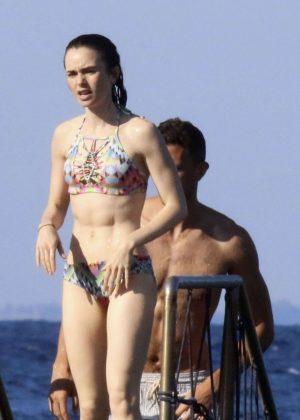 Lily Collins in Bikini at a beach in Ischia