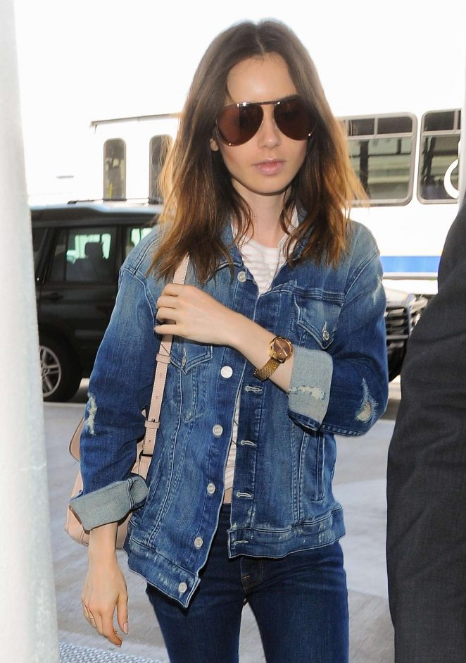 Lily Collins in Jeans at LAX Airport in LA