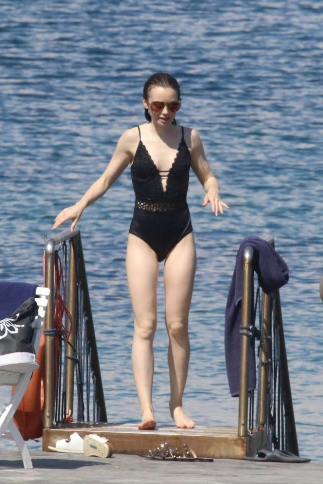 Lily Collins in Swimsuit at the beach in Italy