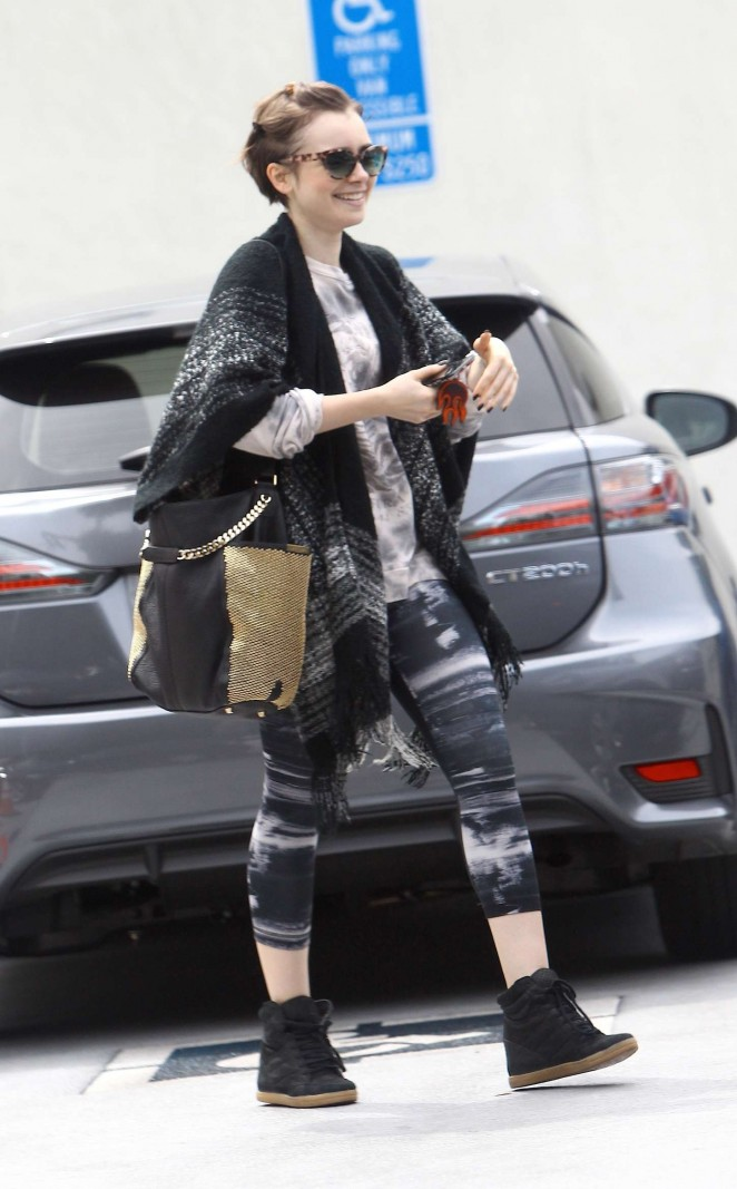 Lily Collins in Tights Leaving a gym in West Hollywood