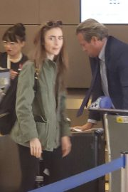 Lily Collins - Leaving LAX Airport in LA