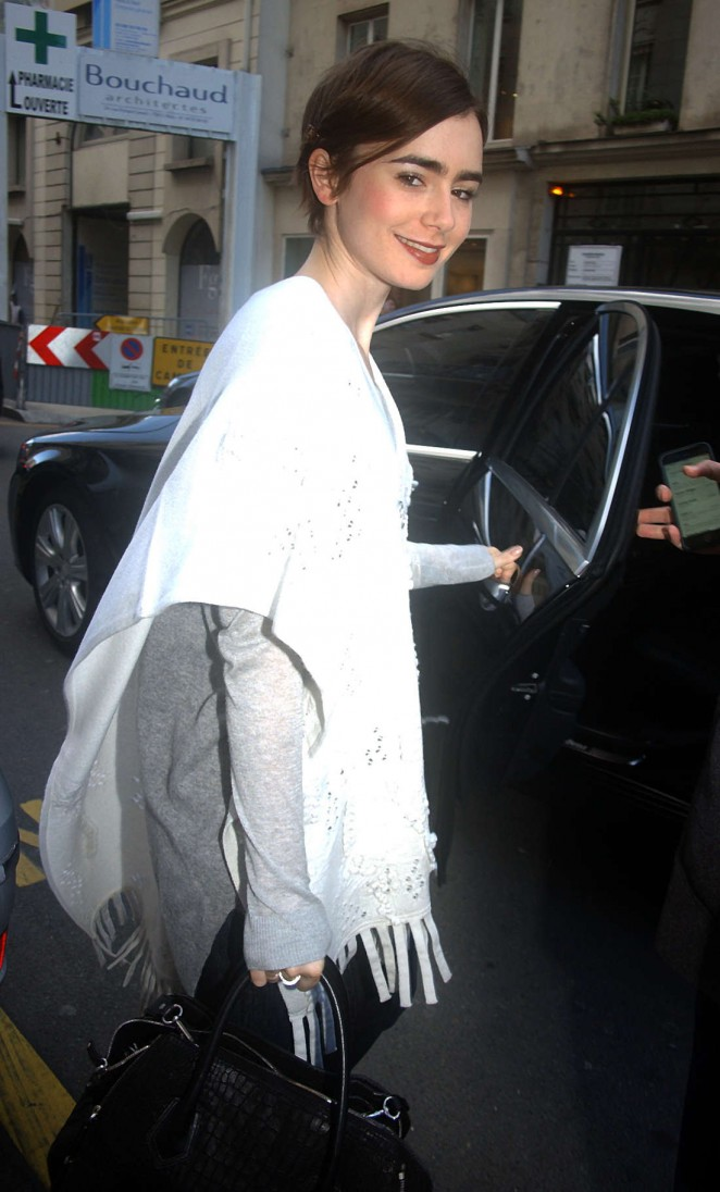 Lily Collins – Out and about in Paris