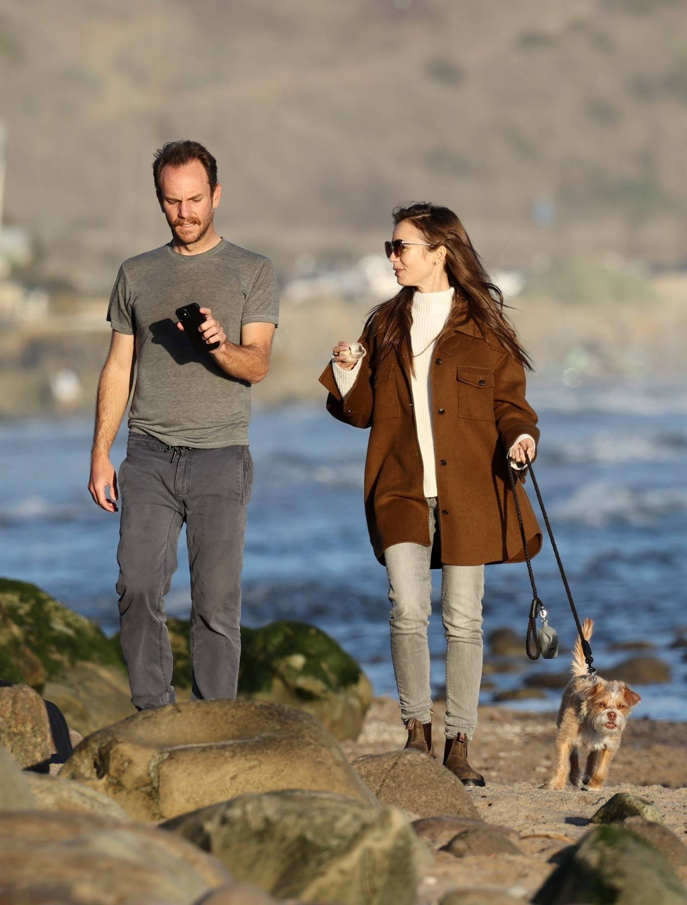 Lily Collins - Out for a walk on the beach in Carpinteria