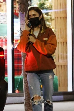 Lily Collins - Shopping candids at Tailwaggers in West Hollywood