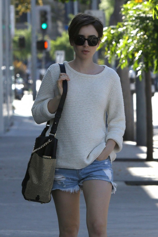 Lily Collins in Jeans Shorts Shopping in West Hollywood