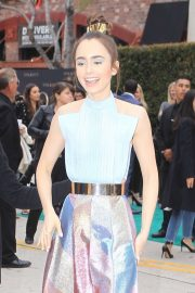 Lily Collins - Signs autographs for fans in Westwood