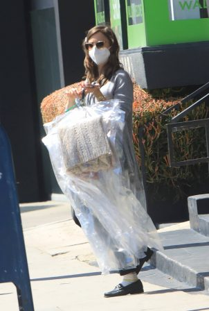 Lily Collins - Spotted while out to pick her laundry in West Hollywood