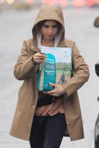 Lily Collins - Steps out in the rain to pick up dog food in Los Angeles