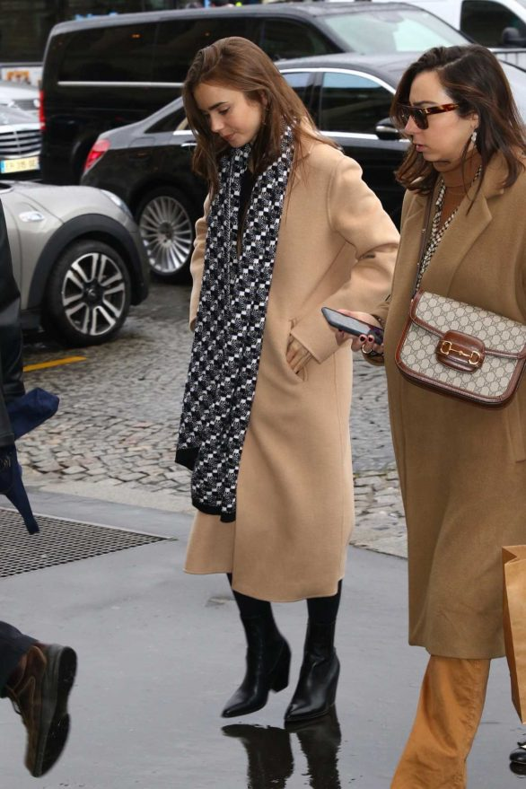 Lily Collins - Wears long coat while out in Paris