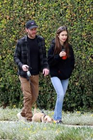 Lily Collins with her boyfriend out taking her dog for a walk in Beverly Hills
