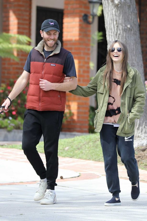 Lily Collins with her boyfriend takes her dog out for a walk in Los Angeles