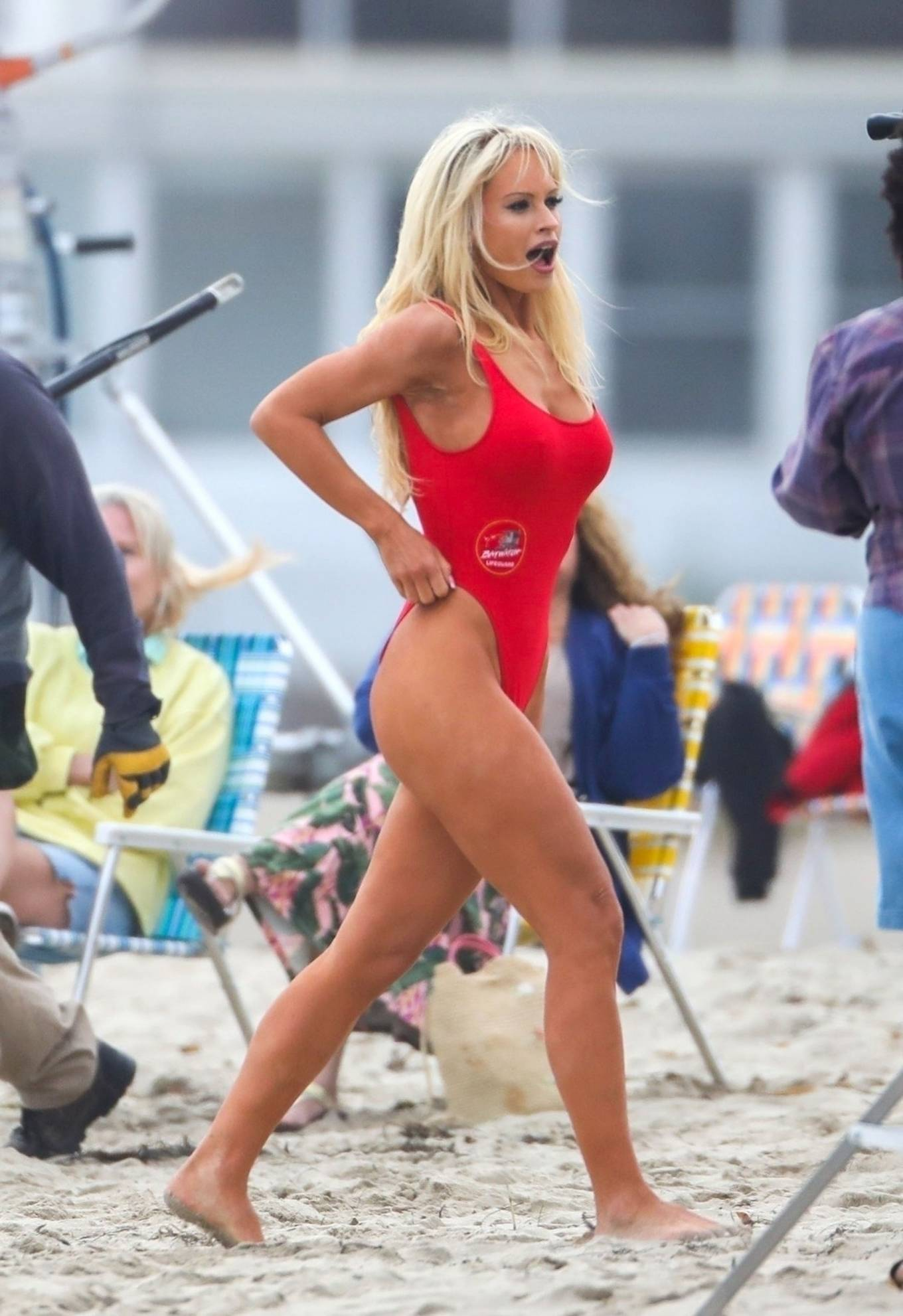 Lily James 2021 : Lily James – As Pamela Anderson in red swimsuit films Pam and Tommy in Malibu-02