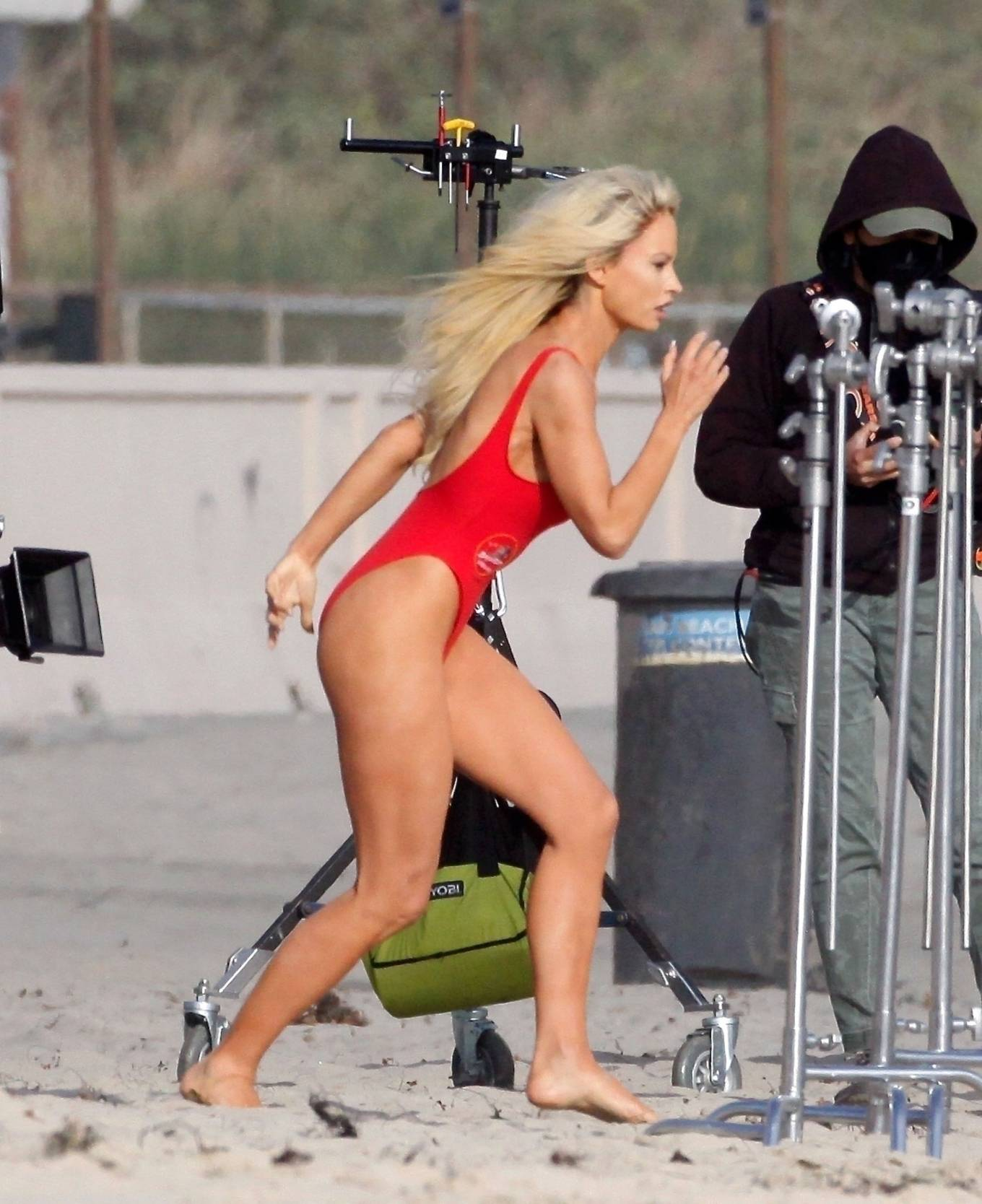 Lily James 2021 : Lily James – As Pamela Anderson in red swimsuit films Pam and Tommy in Malibu-03