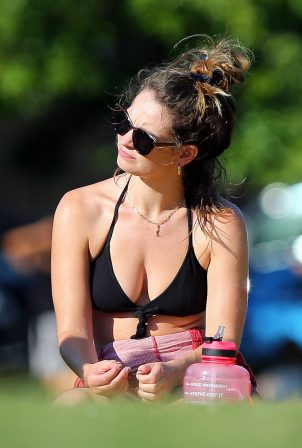 Lily James in Black Bikini sunbathing in London