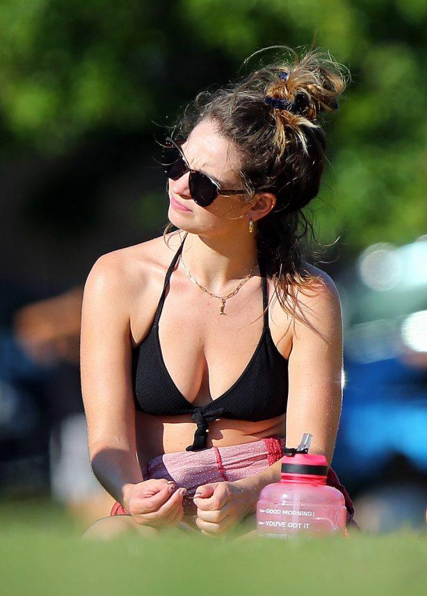 Lily James in Black Bikini sunbathing in London