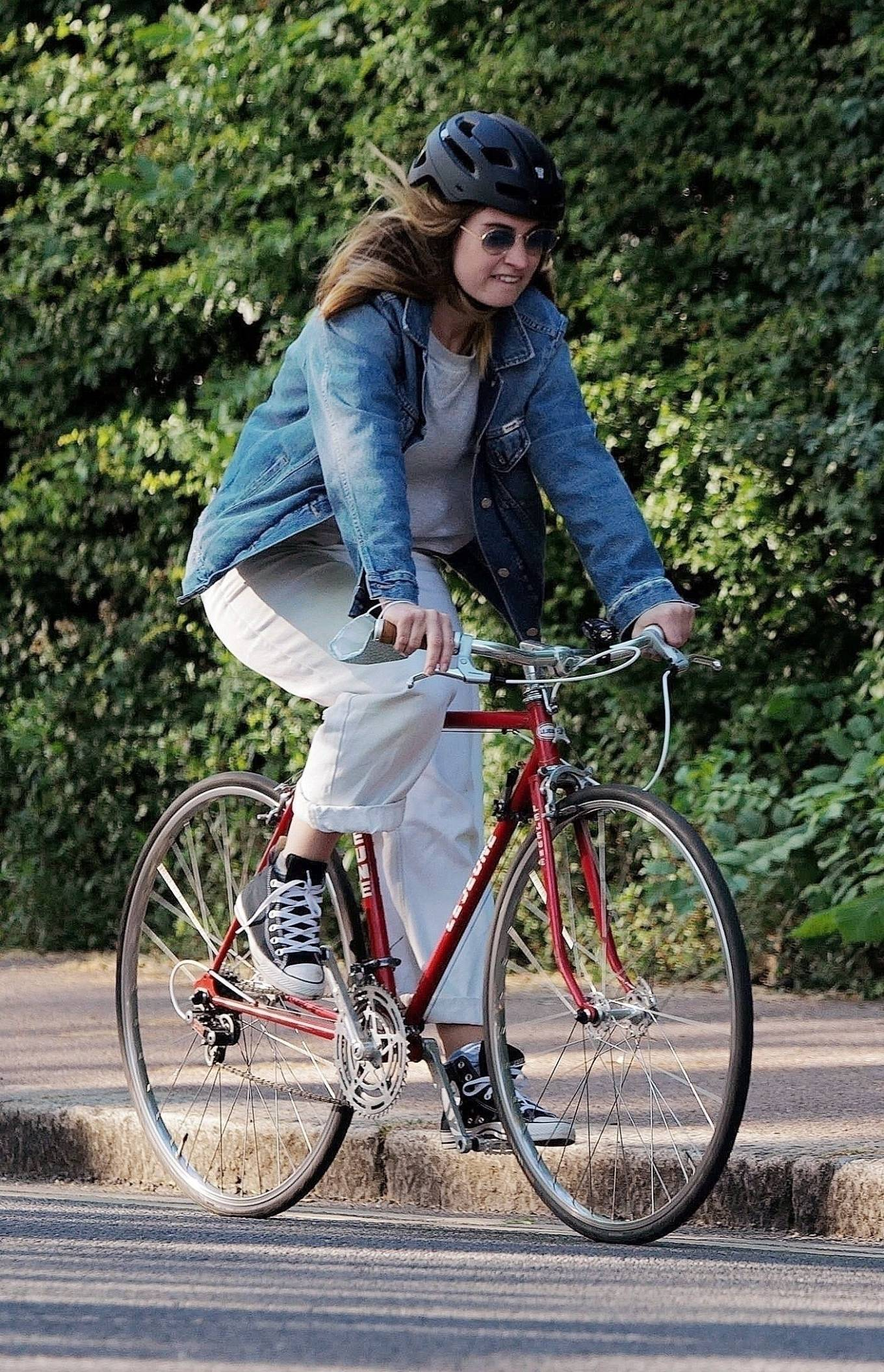 Lily James - Riding her bike in London