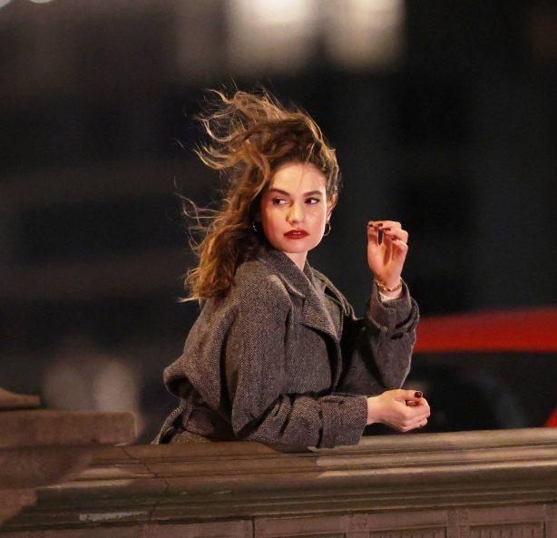 Lily James - Seen on set walking over Battersea Bridge in London