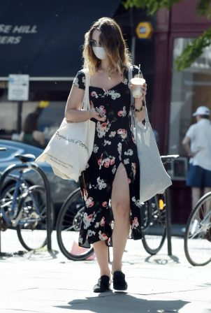 Lily James - Wearing a high slit flowerprint dress in Primrose Hill