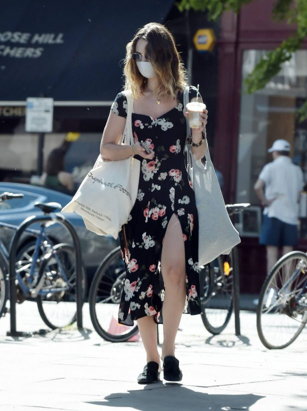 Lily James - Wearing a high slit flowerprint dress in Primrose Hill