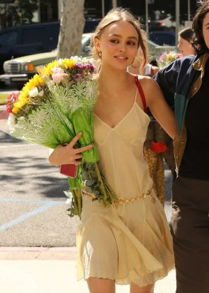 Lily Rose Depp at high school's graduation ceremony in Glendale