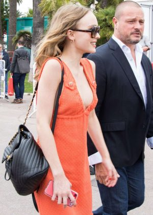 Lily Rose Depp in Orange Dress out in Cannes